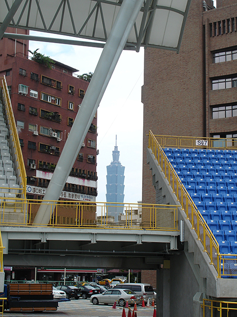 This is a photo of Taipei 101, a landmark skyscraper building in Taipei. We caught a glimpse of it on a site visit at the Taipei Municipal Stadium.
