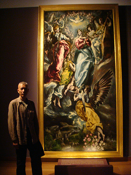 Cai Guo-Qiang standing next to El Greco's Virgin of the Immaculate Conception at the Museo del Santa Cruz, Toledo. Photo by Chinyan Wong, courtesy Cai Studio