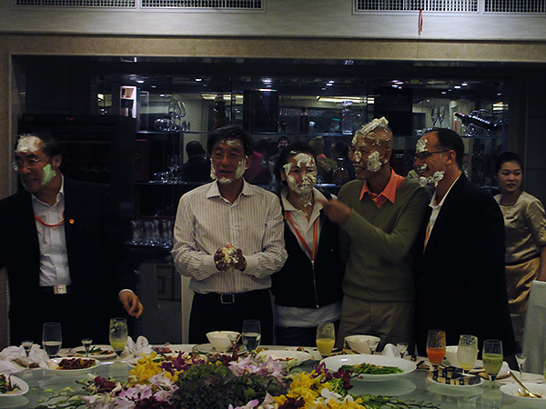 Cai Guo-Qiang, Hong Hong Wu, and Phil Grucci having a little fun with birthday cake for China's 60th Anniversay. Photos courtesy Cai Studio.