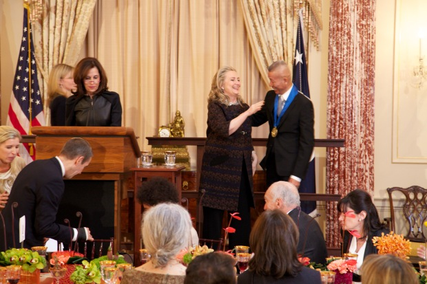 Secretary of State Hillary Rodham Clinton whispering to Cai Guo-Qiang during award ceremony, Washington, D.C., 2012