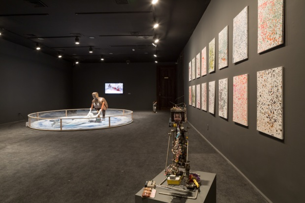 Installation view of Yves Klein's Living Brush, Cai Guo-Qiang Fire Ignition Robot, and Dot-Painting Damien Hirst as part of Wu Yulu's Robot Factory, Centro Cultural Banco do Brasil, Rio de Janeiro, 2013 Photo by Joana França