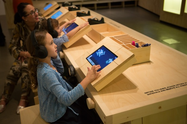 Children using an interactive app to design virtual fireworks in Let's Create an Exhibition with a Boy Named Cai at Children Art Centre, Gallery of Modern Art, Brisbane, 2013. Photo by Yuyu Chen, courtesy Cai Studio.