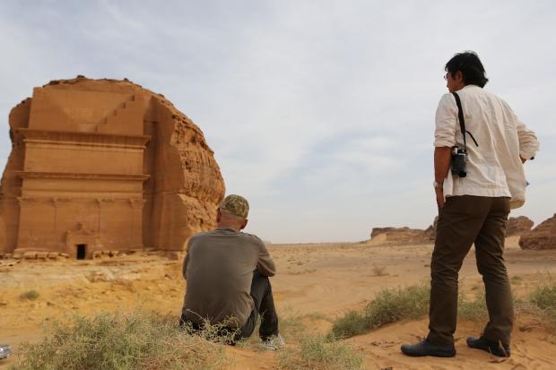 Cai Guo-Qiang with technical director, Tatsumi Masatoshi, looking at the Qasr Farid tomb, Mada'in Saleh, Saudi Arabia, 2013 Photo by Shu-Wen Lin, courtesy Cai Studio