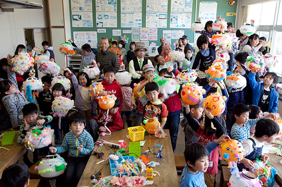 Students with lanterns they constructed in Sebastian Masuda's Let's Make Some Kawaii Lanterns, Iwaki, Japan, 2014. Photo by Wen-You Cai, courtesy Cai Studio.